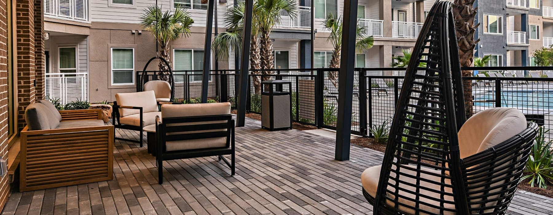 outdoor lounge area with modern wooden decor and spacious seating